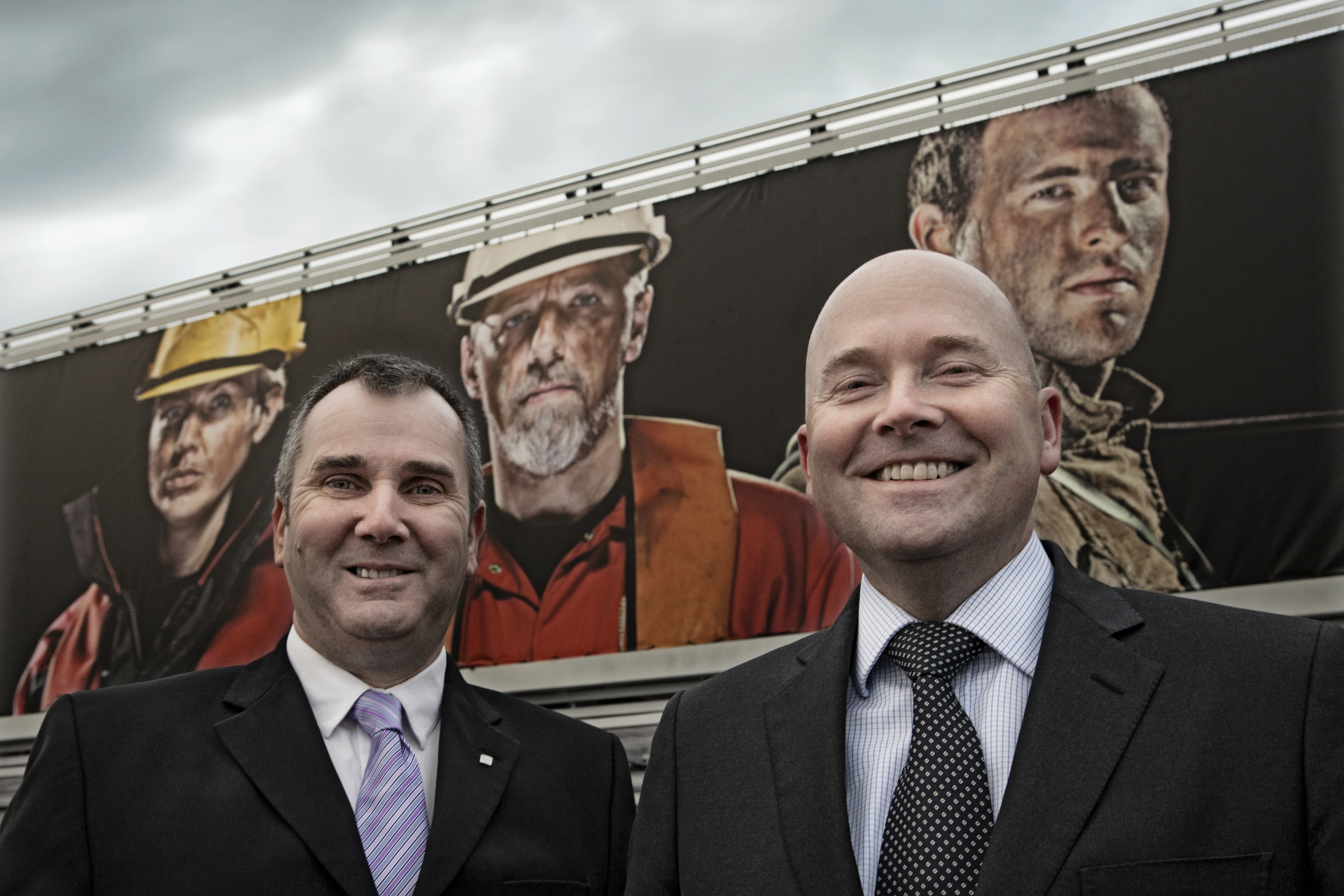 From left: Falck Nutec UK Managing Director, Graham Gall, pictured alongside Aberdeen Airport's Commercial Director, Don Jacobs, with a section of the record-breaking banner ad in the background